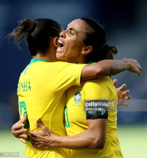 Marta of Brazil celebrates with Debinha after a goal during their Tournament of Nations match against Australia at Children's Mercy Park on July 26...