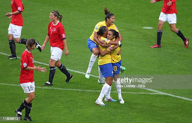 Marta of Brazil celebrates with team mates after scoring the opening goal during the FIFA Women's World Cup Group D match between Brazil and Norway...
