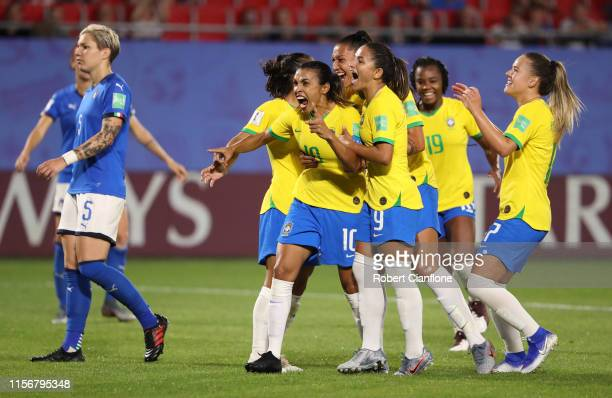 Marta of Brazil celebrates with teammates after scoring her team's first goal during the 2019 FIFA Women's World Cup France group C match between...
