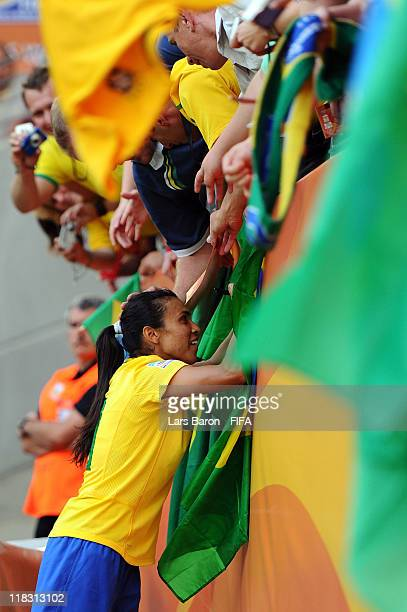 Marta of Brazil celebrates with the fans after winning the FIFA Women's World Cup 2011 Group D match between Equatorial Guinea and Brazil at FIFA...