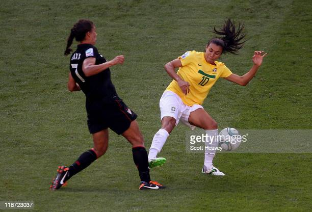 Marta of Brazil challenges Shannon Boxx of USA during the Women's World Cup Quarter Final match between Brazil and USA at RudolfHarbig Stadium on...