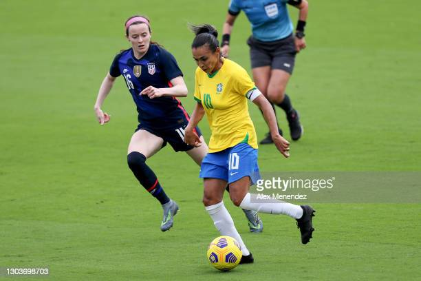 Marta of Brazil controls the ball in front of Rose Lavelle of the United States during the SheBelieves Cup at Exploria Stadium on February 21, 2021...
