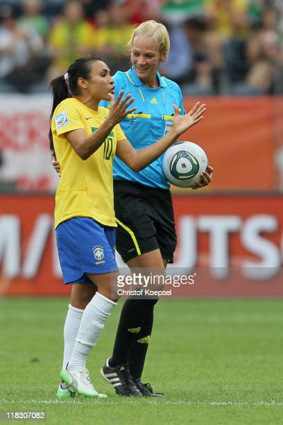 Marta of Brazil discusses with referee Bibiana Steinhaus of Germany during the FIFA Women's World Cup 2011 Group D match between Equatorial Guinea...