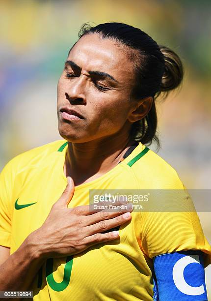 Marta of Brazil during the national anthem during the Olympic Womens Semi Final Football match between Brazil and Sweden at Maracana Stadium on...