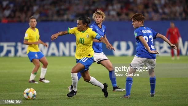 Marta of Brazil escapes the challenge from Manuela Giugliano of Italy during the 2019 FIFA Women's World Cup France group C match between Italy and...