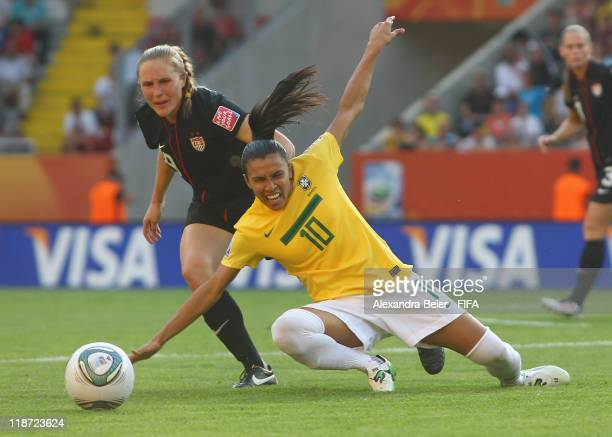 Marta of Brazil fights for the ball with Rachel Buehler of USA during the FIFA Women's World Cup quarter final match between Brazil and USA at...