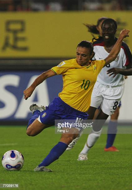 Marta of Brazil fires in a shot during the Womens World Cup 2007 Semi Final match between USA and Brazil at Hangzhou Dragon Stadium on September 27...