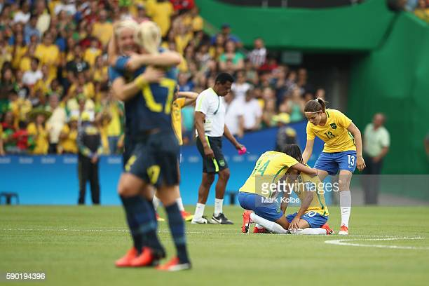 Marta of Brazil goes to ground looking dejected following the Women's Football Semi Final between Brazil and Sweden on Day 11 of the Rio 2016 Olympic...