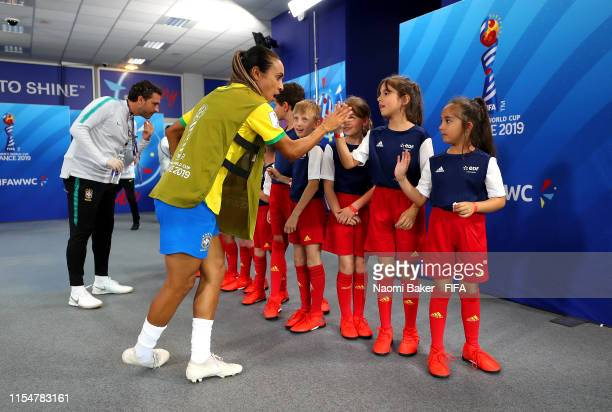 Marta of Brazil high fives mascots in the tunnel prior to the 2019 FIFA Women's World Cup France group C match between Brazil and Jamaica at Stade...