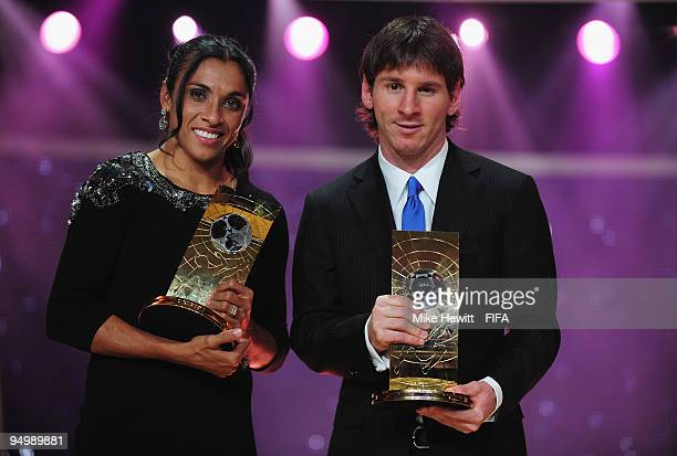 Marta of Brazil holds aloft the FIFA Women's Player of the Year award and and Lionel Messi of Barcelona and Argentina holds aloft the FIFA Men's...