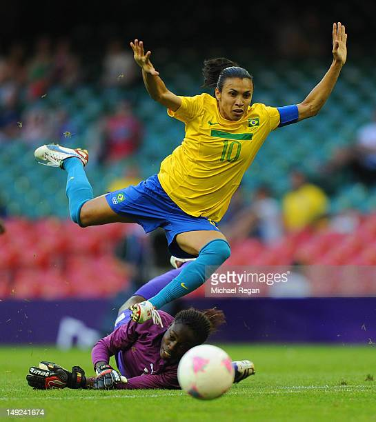 Marta of Brazil in action with goalkeeper Annette Ngo Ndom of Cameroon during the First Round Women's Football Group E Match of the London 2012...