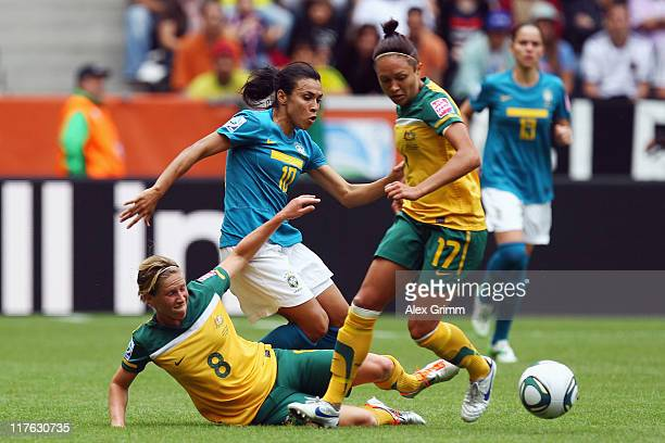 Marta of Brazil is challenged by Elise KellondKnight and Kyah Simon of Australia during the FIFA Women's World Cup 2011 Group D match between Brazil...