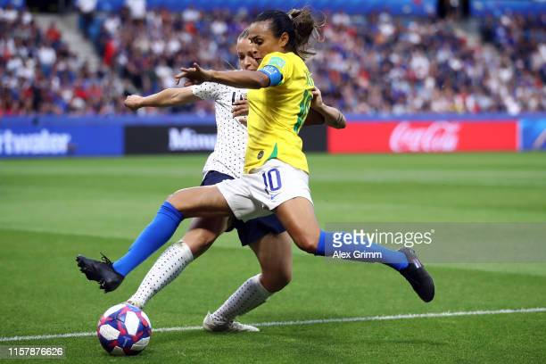 Marta of Brazil is challenged by Marion Torrent of France during the 2019 FIFA Women's World Cup France Round Of 16 match between France and Brazil...