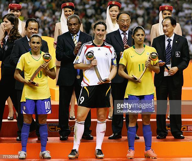 Marta of Brazil is honored with the adidas golden ball Birgit Prinz of Germany is honored with the adidas silver ball and Christiane of Brazil is...