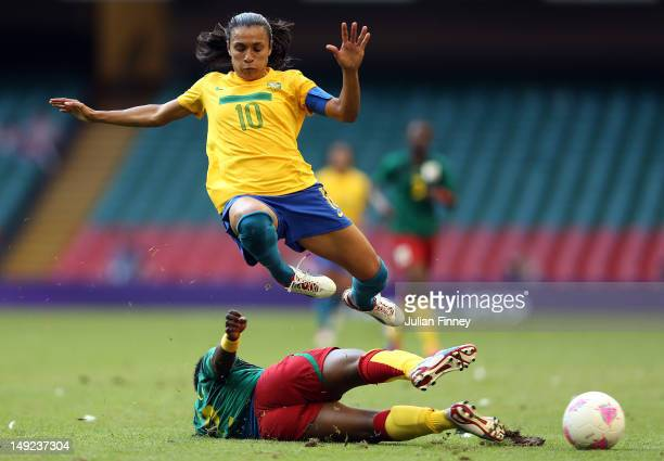 Marta of Brazil is tackled by Christine Manie of Cameroon during the Women's Football first round Group E Match of the London 2012 Olympic Games...