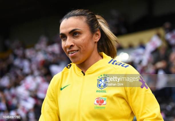 Marta of Brazil leads her team out during the International Friendly match between England Women and Brazil Women at Meadow Lane on October 6 2018 in...