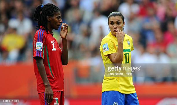 Marta of Brazil looks on next to Bruna of Equatorial Guinea during the FIFA Women's World Cup 2011 Group D match between Equatorial Guinea and Brazil...