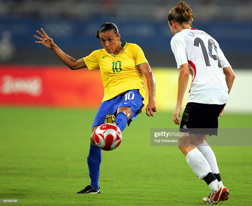 Marta of Brazil passes the ball past Simone Laudehr of Germany during the Women's Semi Final match between Brazil and Germany at Shanghai Stadium on Day 10 of the Beijing 2008 Olympic Games on August 18, 2008 in Shanghai, China.