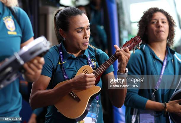 Marta of Brazil plays a ukulele as she arrives at the stadium prior to the 2019 FIFA Women's World Cup France group C match between Brazil and...