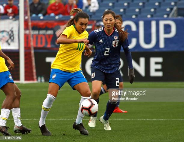 Marta of Brazil plays against Rumi Utsugi of Japan during the first half of the 2019 SheBelieves Cup match between Brazil and Japan at Nissan Stadium...