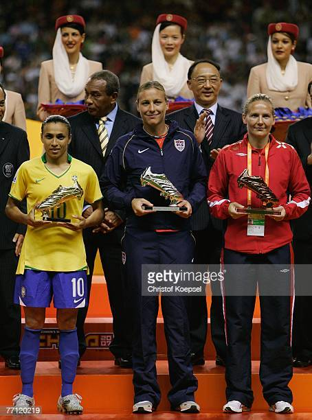 Marta of Brazil presents the adidas golden shoe Abby Wambach of the USA presents the adidas silver shoe and Ragnhild Gulbrandsen of Norway presents...