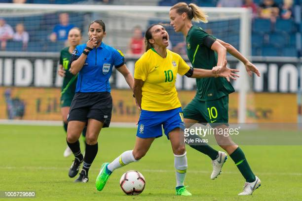 Marta of Brazil reacts to being held by Emily Van Egmond of Australia during the first half of the 2018 Tournament Of Nations on July 26 2018 at...