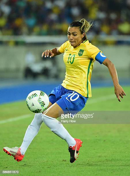 Marta of Brazil runs with the ball during the Women's Group E first round match between Brazil and Sweden on Day 1 of the Rio 2016 Olympic Games at...