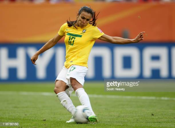 Marta of Brazil scores their first goal from the penalty spot during the Women's World Cup Quarter Final match between Brazil and USA at RudolfHarbig...