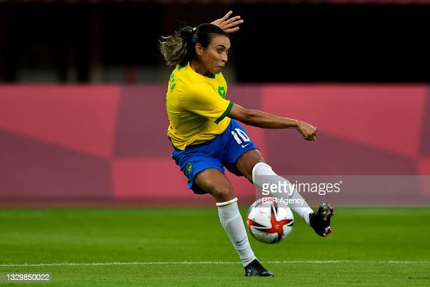 Marta of Brazil shoots to score her sides third goal during the Tokyo 2020 Olympic Football Tournament match between China and Brazil at Miyagi...