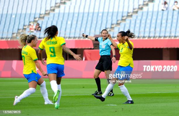 Marta of Team Brazil celebrates after scoring their side's first goal during the Women's First Round Group F match between China and Brazil during...
