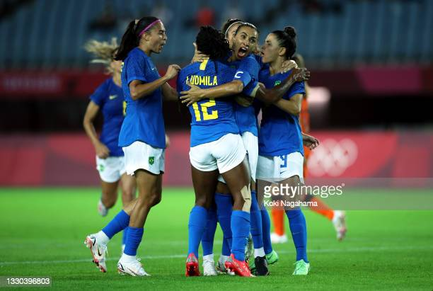 Marta of Team Brazil celebrates after scoring their side's second goal during the Women's First Round Group F match between Netherlands and Brazil on...