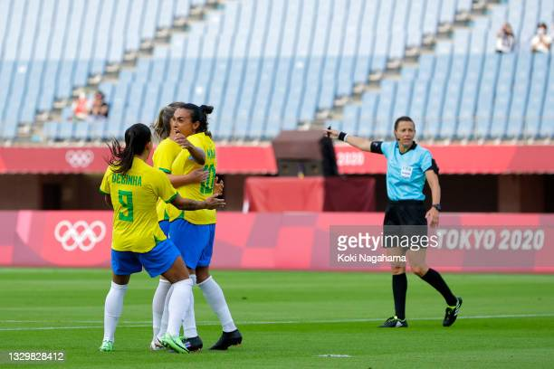 Marta of Team Brazil celebrates with teammates after scoring their side's first goal during the Women's First Round Group F match between China and...