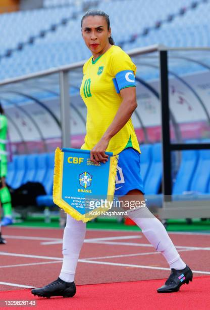 Marta of Team Brazil leads the team on to the pitch prior to the Women's First Round Group F match between China and Brazil during the Tokyo 2020...
