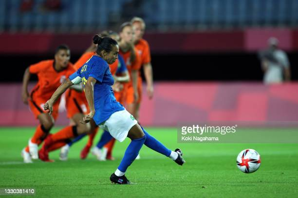 Marta of Team Brazil scores their side's second goal from the penalty spot during the Women's First Round Group F match between Netherlands and...