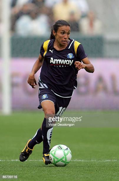 Marta of the Los Angeles Sol plays the ball on the attack in the second half during their inaugural WPS match against the Washington Freedom at The...
