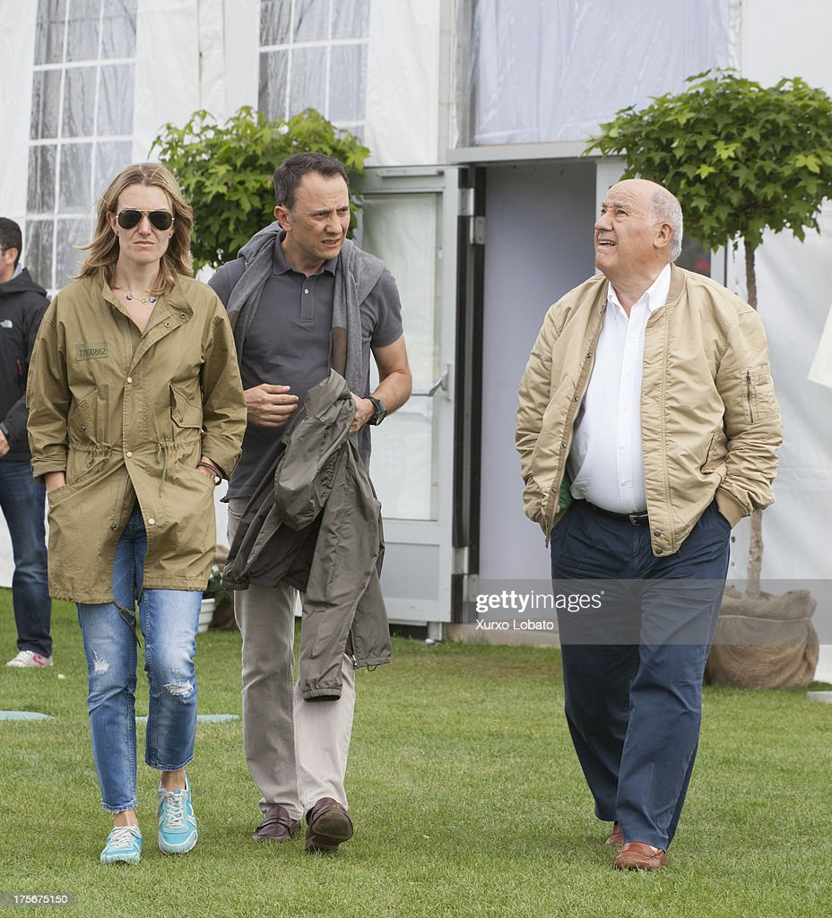 Marta Ortega (L) and Amancio Ortega (R) attend CSI Casas Novas Horse Jumping Competition 2013 near Arteixo on July 27, 2013 in A Coruna, Spain.