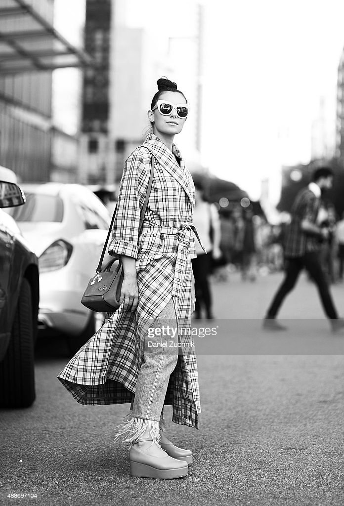 Marta Pozzan is seen outside the DKNY show wearing a Breelayne coat during New York Fashion Show 2016 on September 16, 2015 in New York City.