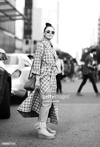 Marta Pozzan is seen outside the DKNY show wearing a Breelayne coat during New York Fashion Show 2016 on September 16 2015 in New York City