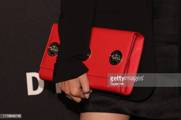 Marta Pozzan purse detail attends the party celebrating the 30th anniversary of DKNY at St Ann's Warehouse on September 09 2019 in New York City