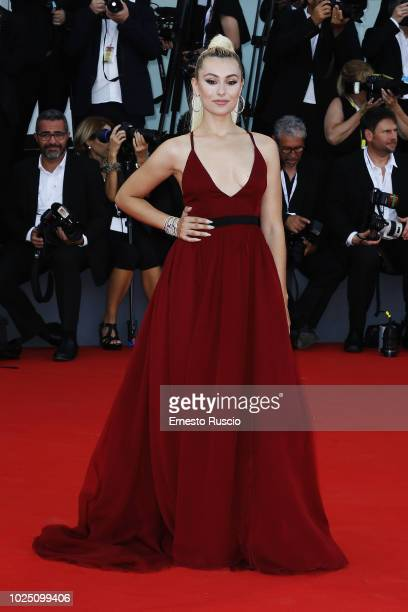 Marta Pozzan walks the red carpet ahead of the opening ceremony and the 'First Man' screening during the 75th Venice Film Festival at Sala Grande on...