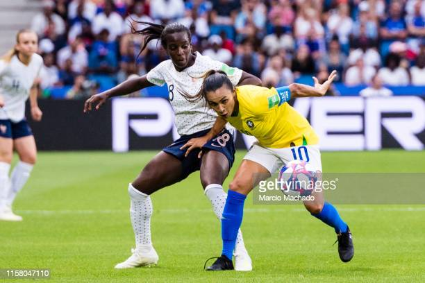 Marta Silva of Brazil in action against Viviane Asseyi of France during the 2019 FIFA Women's World Cup France Round Of 16 match between France and...