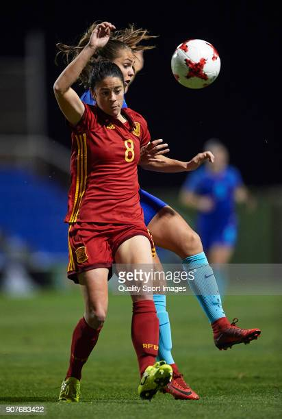 Marta Torrejon Moya of Spain competes for the ball with Lieke Martens of Netherlands during the international friendly match between Spain Women and...