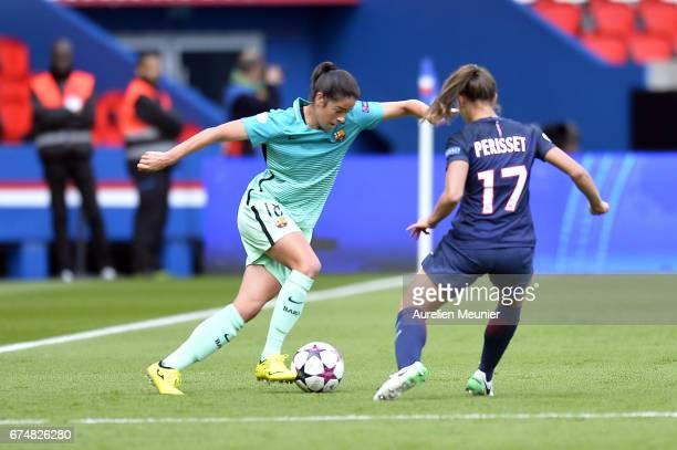 Marta Torrejon of Barcelona and Eve Perisset of Paris SaintGermain fight for the ball during the Women's Champions League match between Paris Saint...