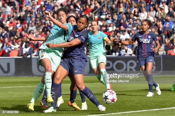 Marta Torrejon of Barcelona and Marie Laure Delie of Paris SaintGermain fight for the ball during the Women's Champions League match between Paris...