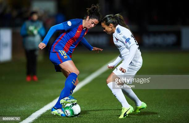 Marta Torrejon of FC Barcelona and Marta Vieira da Silva of FC Rosengard compete for the ball during the UEFA Women's Champions League match between...