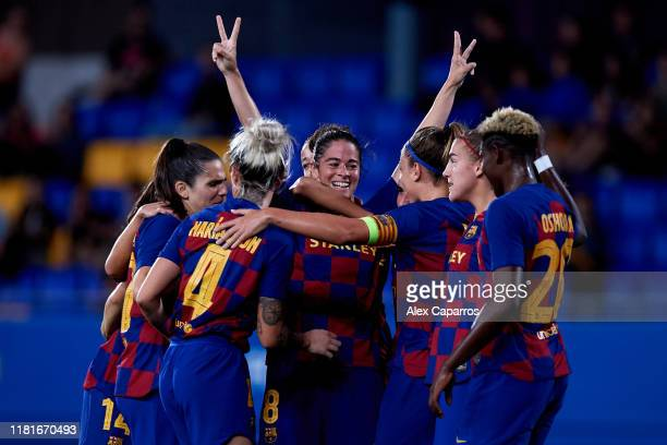 Marta Torrejon of FC Barcelona celebrates with teammates after scoring her team's second goal during the UEFA Women's Champions League Round of 16...