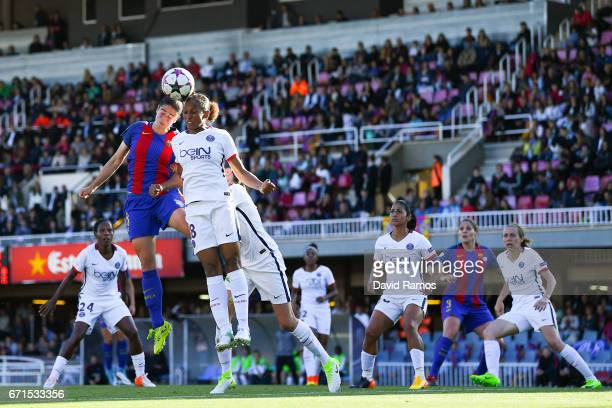 Marta Torrejon of FC Barcelona competes for the ball with MarieLaure Delie of Paris SaintGermain during the UEFA Women's Champions League first leg...