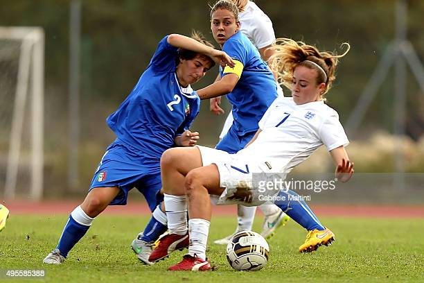 Marta Vergani of Italy U19 women's battles for the ball with Evie Clarke of England U19 women's during the international friendly match between Italy...