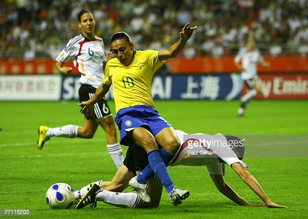 Marta Vieira Da Silva of Brazil battles for the ball with Annike Krahn of Germany during the Women's World Cup 2007 Final between Brazil and Germany...