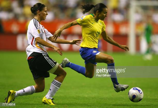 Marta Vieira Da Silva of Brazil battles for the ball with Linda Bresonik of Germany during the Women's World Cup 2007 Final between Brazil and...